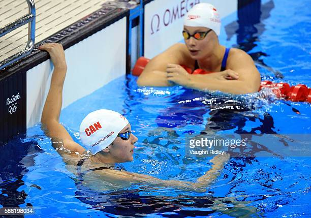Chantel Van Landeghem and Penny Oleksiak of Canada following the Women's 100m Freestyle Heats on Day 5 of the Rio 2016 Olympic Games at the Olympic...