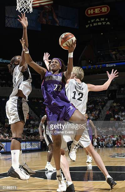 Chantelle Anderson of the Sacramento Monarchs goes to the basket past Margo Dydek and Gwen Jackson of the San Antonio Silver Stars during the game at...