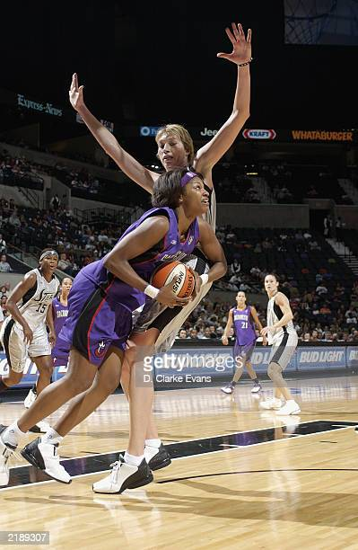 Chantelle Anderson of the Sacramento Monarchs goes to the basket against Margo Dydek of the San Antonio Silver Stars during the game at SBC Center on...