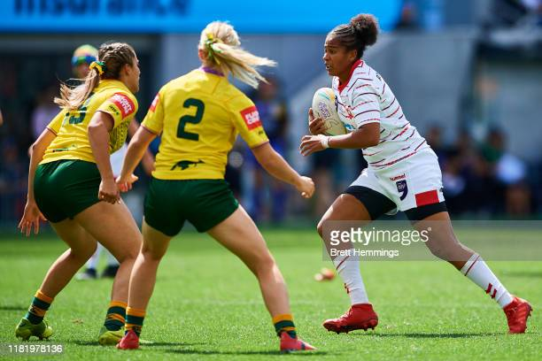Chantelle Crowl of England is tackled during the round 2 Rugby League World Cup 9s match between Australia and England at Bankwest Stadium on October...