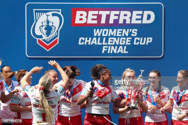 Chantelle Crowl of St Helens celebrates with the Betfred Women's Challenge Cup trophy as her team mates celebrate after the Betfred Women's Super...