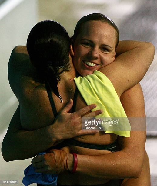 Chantelle Newbery of Australia congratulates gold medalist Blythe Hartley of Canada after the Women's 3m Springboard Final during the diving at the...
