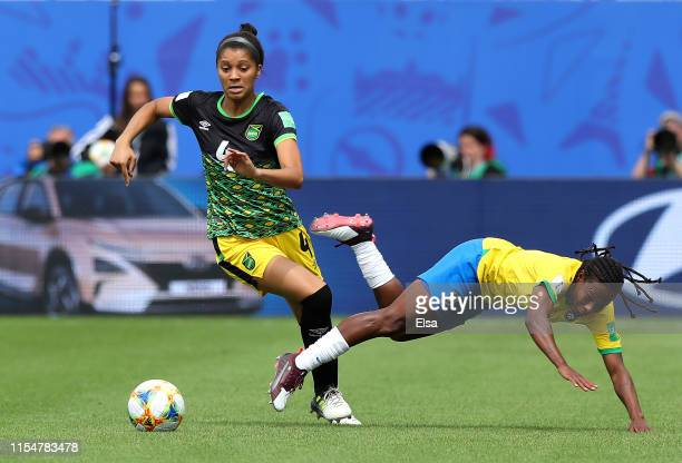 Chantelle Swaby of Jamaica battles for possession with Formiga of Brazil during the 2019 FIFA Women's World Cup France group C match between Brazil...