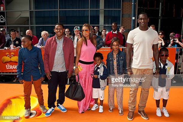 Chantelle Tago and Emile Heskey and children attend the UK premiere of Dr Seuss' The Lorax at cineworld on July 22 2012 in Birmingham England