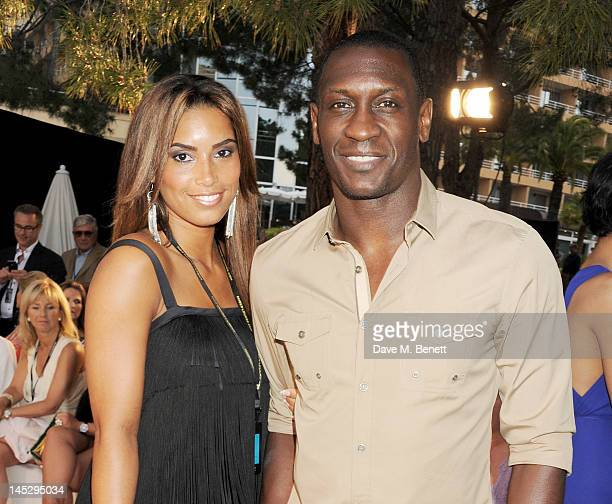 Chantelle Tagoe and footballer Emile Heskey attend a cocktail reception during Amber Lounge Fashion Monaco 2012 at Le Meridien Beach Plaza Hotel on...