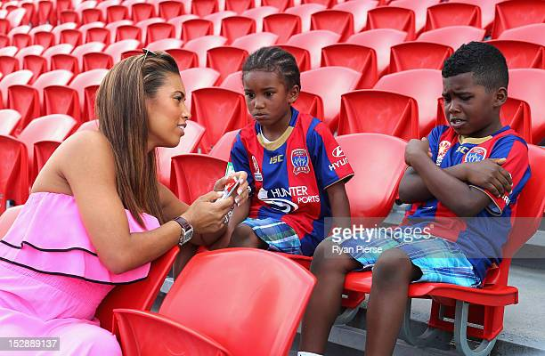 Chantelle Tagoe fiancee of Emile Heskey of Newcastle Jets and their children Reigan Heskey and Jaden Heskey look on during their fathers first...
