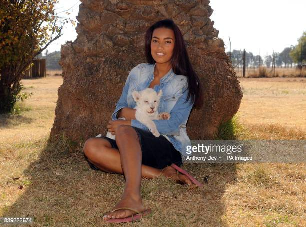 Chantelle Tagoe poses with a 6weekold white lion cub called Acinony during a visit to the Cheetah Experience in Bloemfontein South Africa