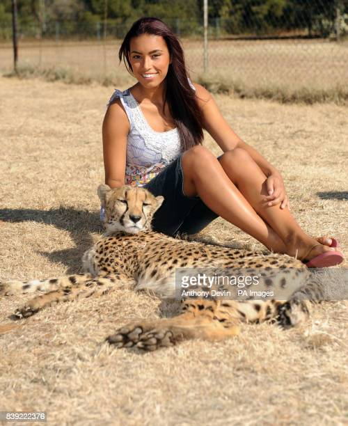 Chantelle Tagoe poses with a two and a half year old cheetah called Bibi during a visit to the Cheetah Experience in Bloemfontein South Africa