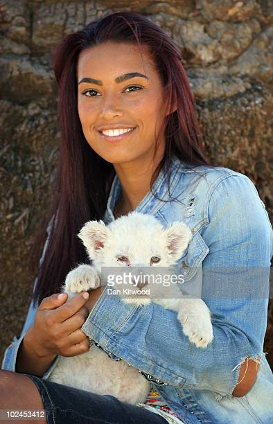Chantelle Tagoe the fiancee of England international football player Emile Heskey sits with Acinonyx the six week old white Lion cub at the Cheetah...