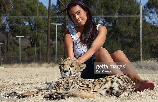 Chantelle Tagoe the fiancee of England international football player Emile Heskey sits with Bibi the Cheetah at the Cheetah Experience on June 27...