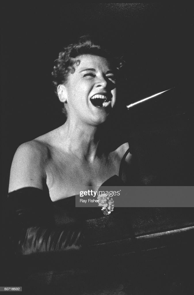 Chanteuse Hildegarde performing on stage.