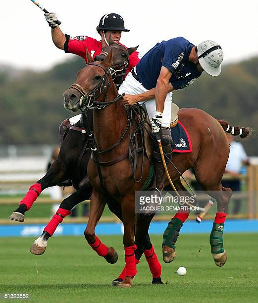 France's Matthieu Delfosse shots the ball ahead Chili's Romano Vercellino , 19 September 2004 in Chantilly, during the Polo World championships...