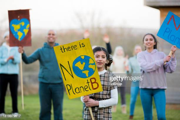chanting for environmental issues - climate activist stock pictures, royalty-free photos & images
