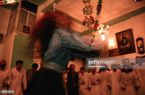 Chanting Kasnazani dervishes surround one of their number who is whirling whilst in a trance during a remembrance ceremony in Sanandaj capital of the...