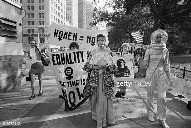 Chanting We want 51 percent of everything women liberationists march around City Hall and down Wall Street here August 26 in celebration of the 51st...