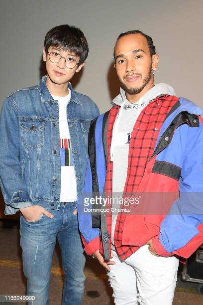Chanyeol and Lewis Hamilton attend the Tommy Hilfiger TOMMYNOW Spring 2019 TommyXZendaya Premieres at Theatre des ChampsElysees on March 02 2019 in...