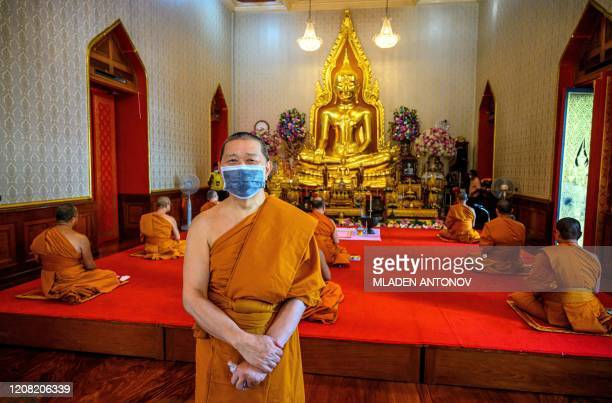 Chao Khun Thongchai, abbot of the Wat Traimit Temple , arrives for a televised anti-plague prayer amid lockdown restrictions to contain the spread of...