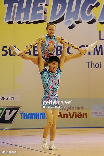 Chao Ma and Zijing Huang of China compete in the FinalSenior Mixed Pairs during the 5th Asian Aerobic Gymnastics Championships at Nguyen Du Culture...