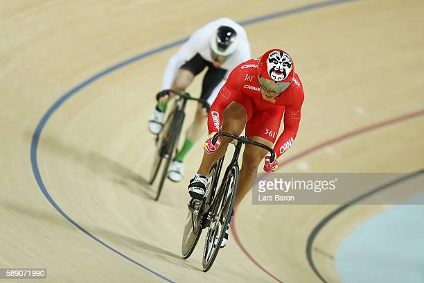 Chao Xu of China and Joachim Eilers of Germany compete during the Men's Sprint 1/8 Finals on Day 8 of the Rio 2016 Olympic Games at the Rio Olympic...