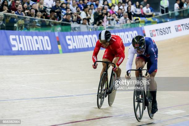 Chao Xu of China competes against Callum Skinner of Britain in the men's sprint final at the Hong Kong Velodrome during the Track Cycling World...