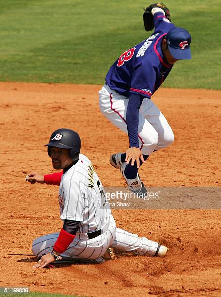 ChaoHang Cheng of Chinese Taipei jumps over Norihiro Nakamura of Japan when Nakamura was trying to break up a double play during the baseball...