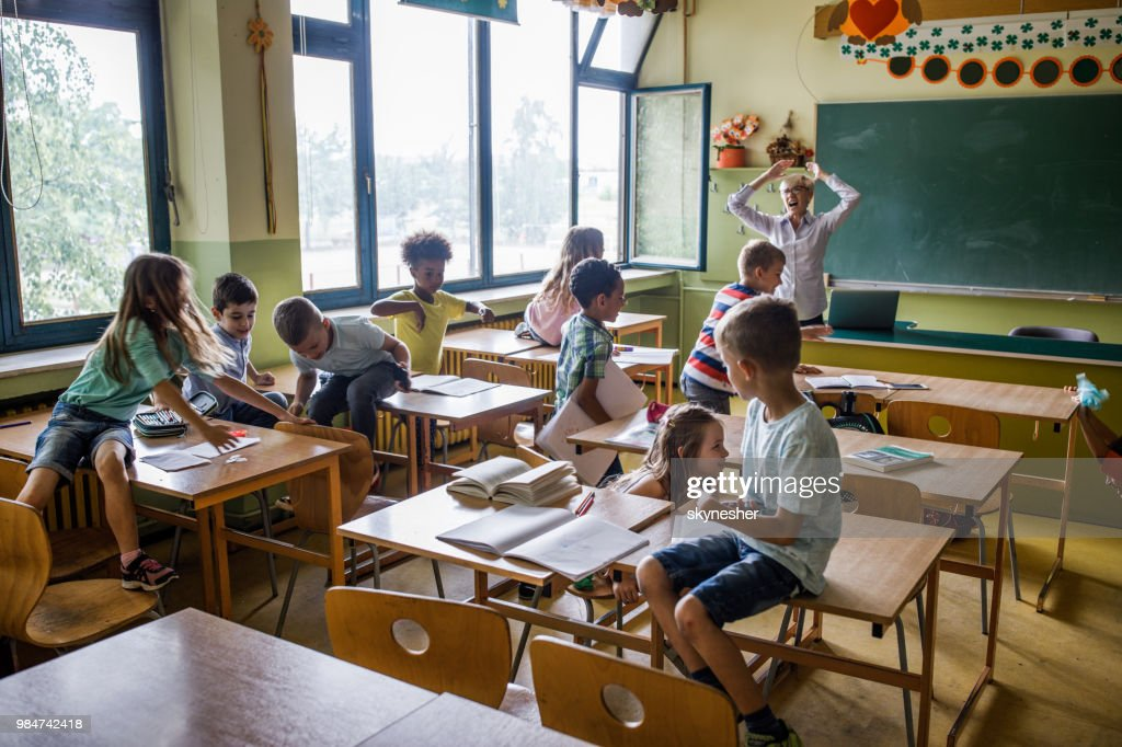Chaos in the classroom of elementary school! : Stock Photo