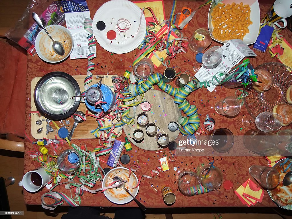 Chaos on table top after New Years Eve party : Stock Photo