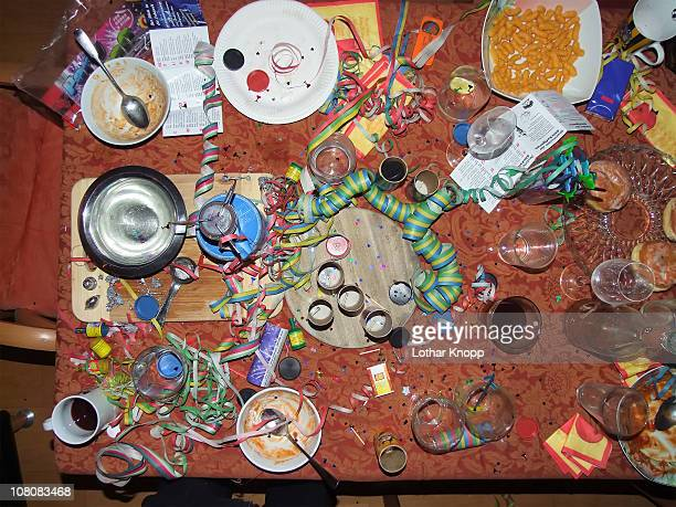chaos on table top after new years eve party - after party stock pictures, royalty-free photos & images