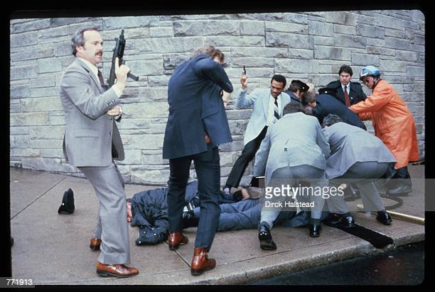 Chaos surrounds shooting victims immediately after the assassination attempt on President Reagan, March 30 by John Hinkley Jr. Outside the Hilton...