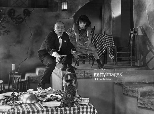 A chaotic scene as a dog steals food from a cafe table in a scene from the film 'Sally' with Colleen Moore and Lloyd Hughes The film was directed by...