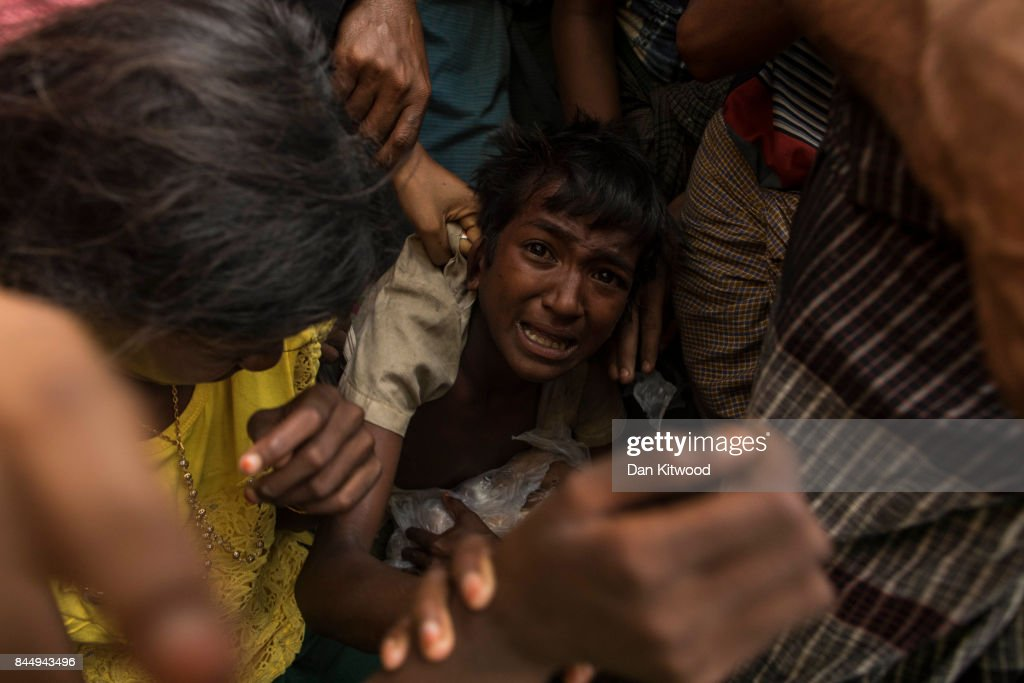 Chaotic scenes as rice is distributed to Rohingya refugees on September 09, 2017 in Gundum, Bangladesh. Recent reports have suggested that around 290,000 Rohingya have now fled Myanmar. Those who left have spoken of violence erupting in Rakhine state, when the country's security forces allegedly launched an operation against the Rohingya Muslim community.