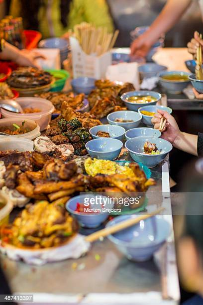 Chaotic streetfood servings on table
