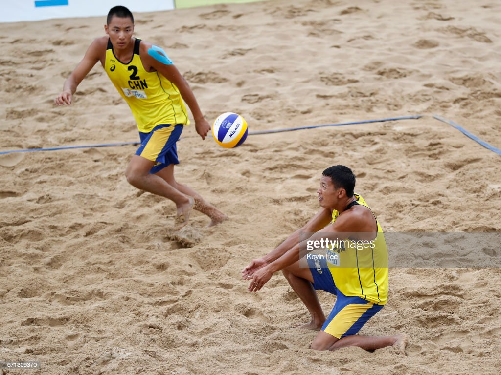 Chaowei Zhou(L) and Zhuoxin Li of China in action at the FIVB Beach Volleyball World Tour Xiamen Open 2017 on April 21, 2017 in Xiamen, China.
