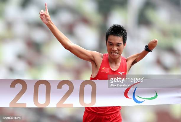 Chaoyan Li of Team China reacts as he crosses the finish line to win the gold medal on day 12 of the Tokyo 2020 Paralympic Games at Olympic Stadium...