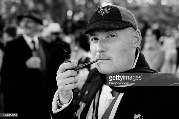 A chap smokes a pipe between events on July 13 2006 in London England The Chap Olympics involves a very traditional British take on athletic events...