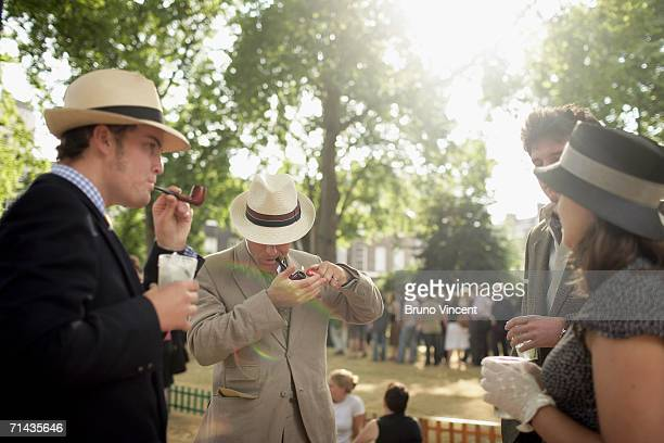 A chap smokes a pipe between events on July 13 2006 in London The Chap Olympics involves a very traditional British take on athletic events with Gin...