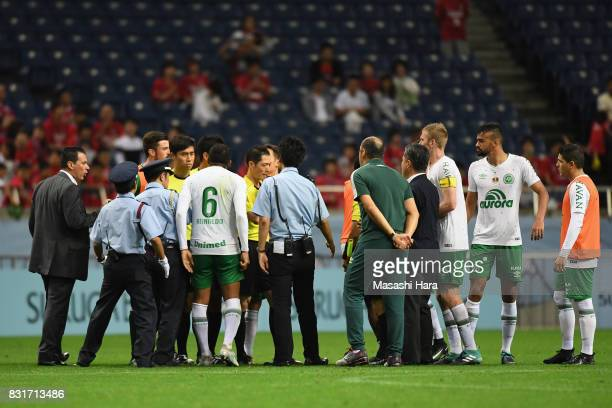 Chapecoense players and staffs protest to the match officials while security staffs intervene after their 0-1 defeat in the Suruga Bank Championship...