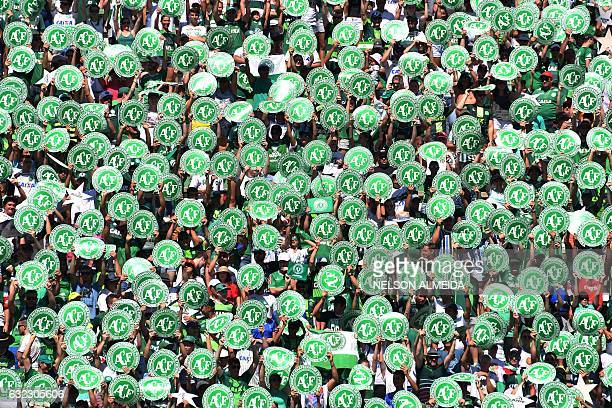 Chapecoense's supporters cheer before a friendly football match against Palmeiras Brazilian Champion 2016 at the Arena Conda stadium in Chapeco Santa...