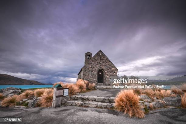 chapel against cloudy sky at dusk - christchurch stock pictures, royalty-free photos & images