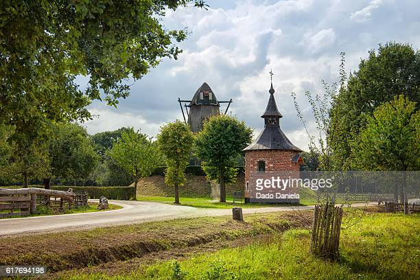 chapel and windmill - ardennes department france stock photos and pictures