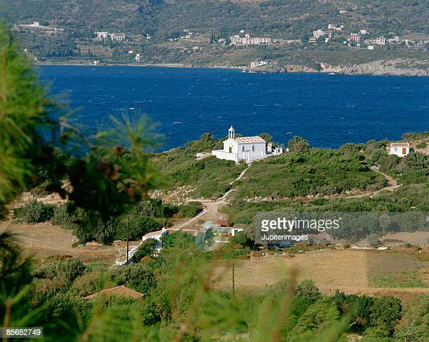 chapel by ocean , samos , greece - samos stock photos and pictures