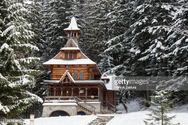 chapel of the sacred heart of jesus in snow in jaszczurowka, poland - zakopane stock pictures, royalty-free photos & images