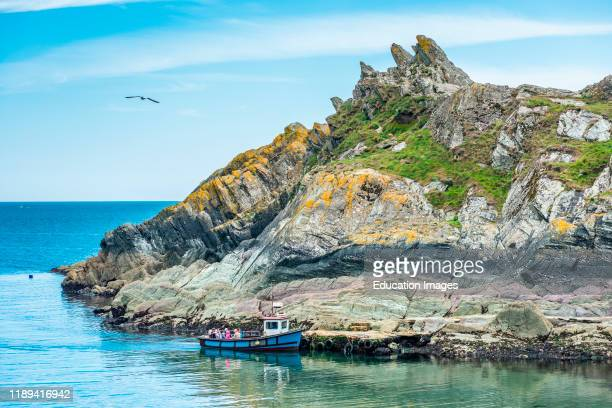 Chapel Rock at the entrance to Polperro harbor in Cornwall England UK