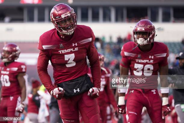 Chapelle Russell and Sam Franklin of the Temple Owls celebrate after Russell recovered a fumble for a touchdown in the fourth quarter against the...