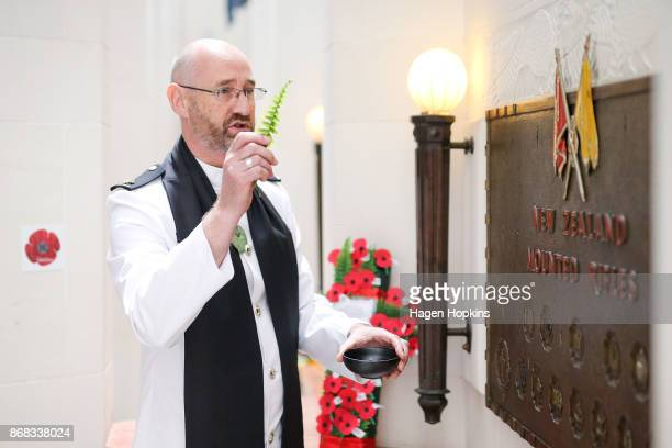 Chaplain Class Two Peter Olds rededicates the New Zealand Mounted Rifles Brigade plaque during Battle of Beersheba commemorations in the Hall of...