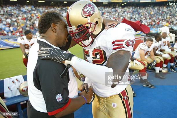 Chaplain Earl Smith prays with Patrick Willis of the San Francisco 49ers during the game against the San Diego Chargers on August 30 2007 at Qualcomm...
