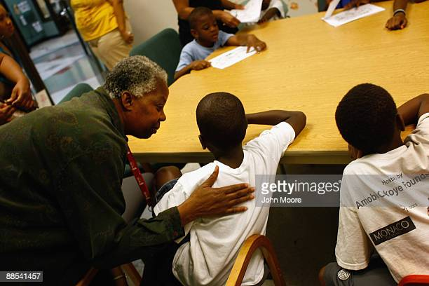 Chaplain Judy Dixon counsels a child during scripture study hour at the Center of Hope shelter for homeless women and children on June 16, 2009 in...