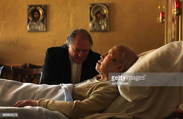 Chaplain Larry Grimm prays with terminally ill hospice resident Chiu Ning Yuan in the chapel of the Hospice of Saint John on August 20 2009 in...