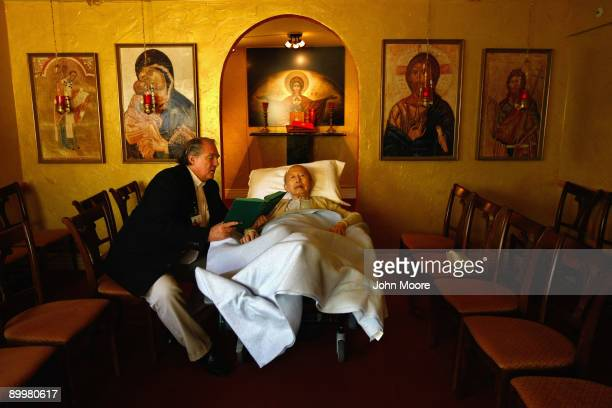 Chaplain Larry Grimm reads scripture to terminally ill hospice resident Chiu Ning Yuan in the chapel of the Hospice of Saint John on August 20 2009...