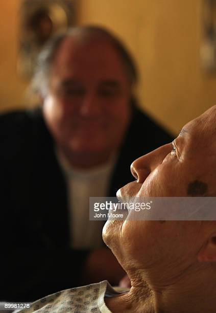Chaplain Larry Grimm sits with terminally ill hospice resident Chiu Ning Yuan in the chapel of the Hospice of Saint John on August 20 2009 in...